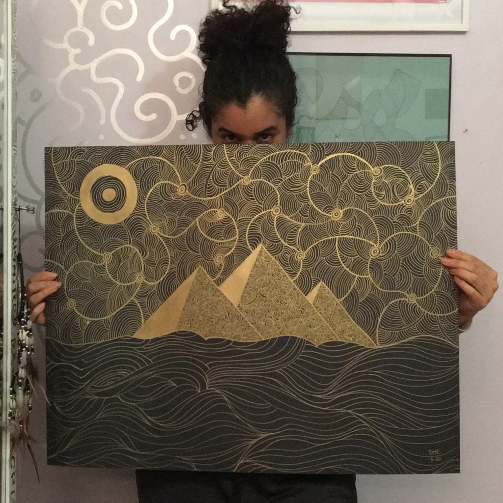 daphne essiet holding her drawing of the pyramids