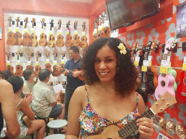daphne essiet with ukulele in uke store